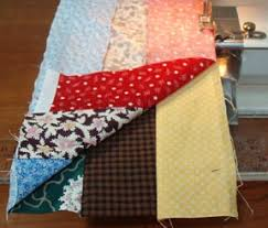 Scrappy Trips pf & Sew this seam the length of the strips turning your panel into a