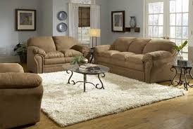 light gray walls with brown leather couch brown sofas cream rug glass