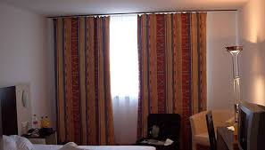 another option that you have when the window meets the wall or when two windows meet the wall is to put up a wall to wall curtain