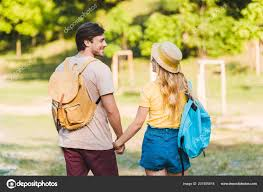 back view happy couple love walking summer park together stockfoto