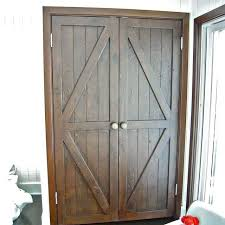hand made custom reclaimed wood bi fold closet doors for a luxury home in malibu by mortise tenon custom furniture custommade com