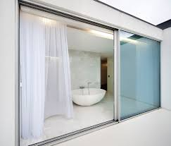 modern glass door designs. Gorgeous Bathroom View Behind Modern Sliding Door Design With Wide Size And Glass Panel On Marble Designs