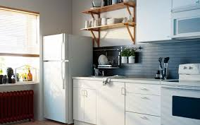 Ikea Kitchen Design With Grey Backsplash And White Drawers Also Wooden  Shelves And White Sink With ...