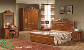 traditional costco bedroom furniture sets with tall hand carved headboard light brown wooden bed platform and
