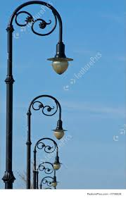 Old Fashioned Street Lights Architectural Details Row Of Old Fashioned Street Lights Receding Into The Distance