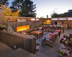 and nothing can beat the heat and ambience of an outdoor fireplace these three modern outdoor spaces show you how to get your flame on