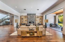 another living room of kris jenner features a stylish fireplace and a nice living room set