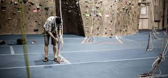 bouldering on artificial rock climbing wall cost with gym climbing basics indoor climbing for beginners rei expert advice
