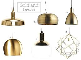 gold hanging lights lighten up with these stunning statement pendant lights yes please gold hanging lights gold hanging lights