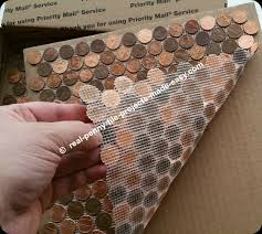 back side of real penny tile showing mesh cut around curved edges of pennies