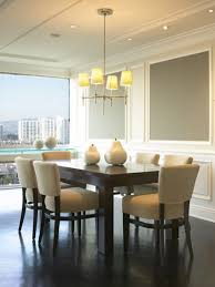 contemporary dining room lighting. lavish dining space which has chandelier as modern room light fixture with silver stainless frame and soft yellow lamps above white ceramic table contemporary lighting t