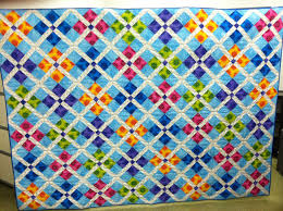 Morning Glory Designs: Calypso Carnival Published & Brenda Weien did a great job of quilting it, as usual and it really glows  with all those bright colors. And I like the feel of the quilt with no  borders. Adamdwight.com