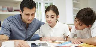 The surprising way parents are helping their children with their     Brain Balance Achievement Centers Mother Helping Children Do Their Homework Stock Photo Image Parents helping  their children with homework Stock