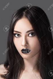 high fashion beauty model with black make up and long hair black lips