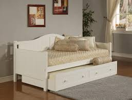 lovely white wooden daybed with trundle added creamy mattress on wooden floors in gray family room ideas