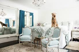 inspiration for a shabby chic style master dark wood floor bedroom remodel in los angeles