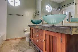 craftsman bathroom with tempered glass sinks
