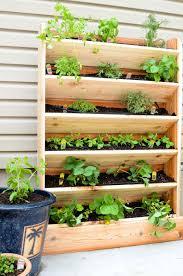 create a diy vertical garden for the perfect small space garden solution this cedar vertical garden has a lot of space to grow your favorite herbs and