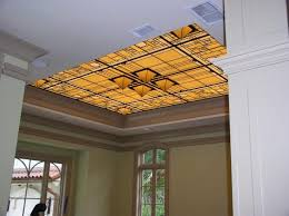 custom made stained glass illuminated dining room ceiling with dimensional pyramids
