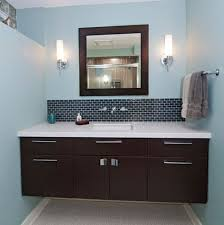 view in gallery dark floating cabinet with a white countertop and an undermount sink