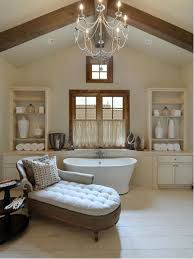 inspiration for a timeless beige tile freestanding bathtub remodel in austin with beige cabinets and beige