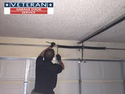 to check for proper balance you must first disconnect the garage door opener if one is installed you can disconnect the garage door opener by pulling the