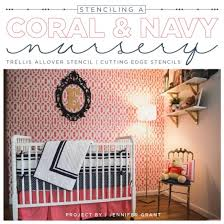 a diy stenciled accent wall in ac and navy nursery using the trellis allover pattern