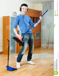 Man Living Room Cheerful Man Playing And Cleaning With Brush In Living Room
