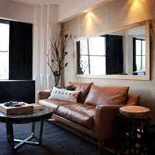 leather couch living room. Example Of A Trendy Living Room Design In Sydney With Beige Walls Leather Couch