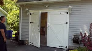 white barn style garage doors bine with gray wall paint