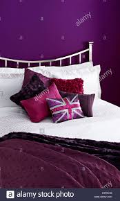 Purple Painted Bedroom Purple Painted Bedroom Purple Cushions Union Jack Stock Photo