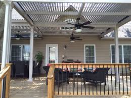 louevered patio cover with wooden fence design and black patio furniture black patio furniture covers
