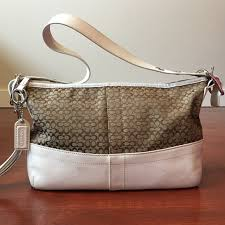 Coach khaki mini signature canvas EW duffel bag.