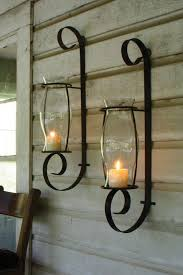 delightful wrought iron candle holder to add interior