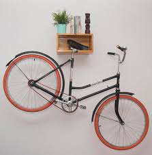 Making sure your home decor doesn't take a hit, this light wood bike rack  doubles as a shelf for ornamental displays, and a convenient place to store  your ...