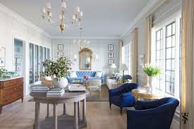 Chic office design Modern Chic Dental Office Lounge Blue Sofa In Front Of French Gilt Mirror Drapery Panels Loader Summer Thornton Design Chic Dental Office Summer Thornton Design