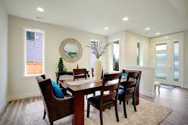 wooden dining room chairs brown dining room chair brown armchairs blue pillows wooden dining table round