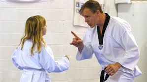 jim grimestad 7th degree grandmaster at red river traditional taekwondo helps 6 year old heather devig with her sparing technique on wednesday martial arts instructor jobs