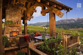 country deck with outdoor stone fireplace mountain view rwa rustic natural mantel outdoor