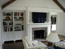 tv stand for fireplace mantel television cabinet above fireplace mantle with accordion style pocket doors flanked tv stand for fireplace