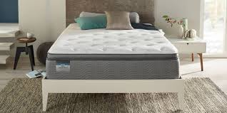 simmons deep sleep mattress. simmons mattress in a modern style white bedroom with fleece blanket deep sleep