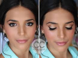 tanned skin brown eyes winged liner winged eyeliner french makeup 1950 s