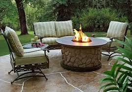 patio ideas with gas fire pit fine patio fine looking rounded fire pit ideas with stones panelling and tables added outdoor grey fabric seater iron base on