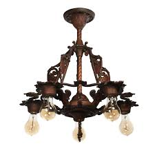 antique spanish revival chandelier with shields overall