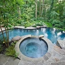 vanishing edge swimming pool w flagstone patio walls in alexandria va i would love this hottubpool setup swimming pool setup88