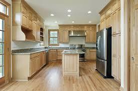 light hardwood kitchen floor and cabinet