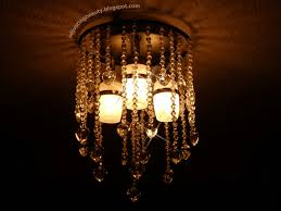 since i do get a bit obsessed with some things i really wanted to make my own chandelier partly because my three in one light is so boring