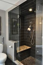 Master bathroom remodel gray tones with tile to the ceilin