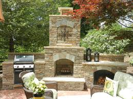 outdoor fireplace with wood burning outdoor fireplace and landscaping in potomac md