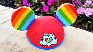 disney world and disney land are now offering pride themed mickey mouse ear hats at